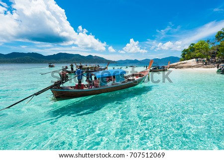 the boat on the crystal clear water in andaman sea Thailand #707512069
