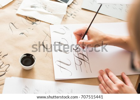 ornamentation, graphic design, education concept. woman preparing writing exercises for learning calligraphy. there is different types of lines and capital letters of russian alphabeth #707515441
