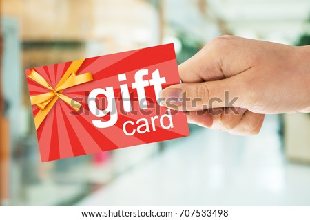 Cropped image of person's hand holding gift card #707533498
