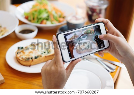 Use mobile phone to capture your meal and share in social network before eating