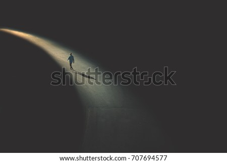 man walking in the night Royalty-Free Stock Photo #707694577