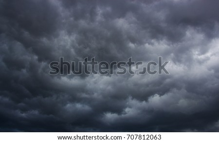 Light in the Dark and Dramatic Storm Clouds background Royalty-Free Stock Photo #707812063