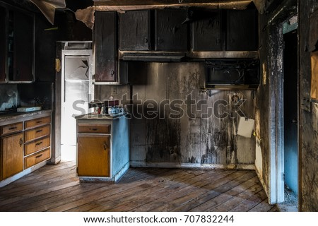 Interior of a home damaged by fire. Royalty-Free Stock Photo #707832244