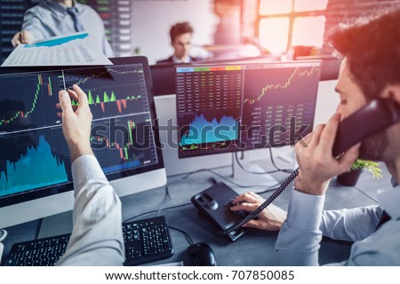 Business team investment trading do this deal on a stock exchange. People working in the office. Royalty-Free Stock Photo #707850085