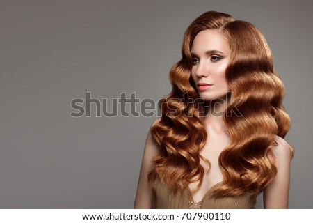 Portrait of woman with long curly beautiful ginger hair.  #707900110