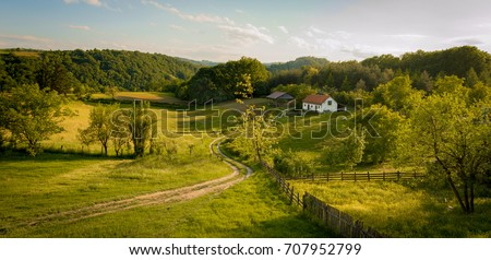 Beautiful summer landscape at sunset. Village near town of Valjevo, western Serbia. Royalty-Free Stock Photo #707952799