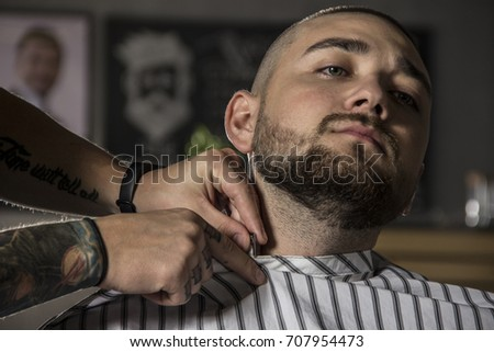 portrait of the man in barbershop preparing to shave his beard #707954473
