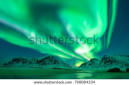 Magnificent Northern lights, Aurora over the beach of Lofoten Islands. Beautiful scene. Solar storm. Top travel destination in Norway. Landscape photography in Norway.