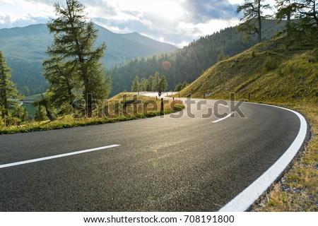 Asphalt road in Austria, Alps in a beautiful summer day, Hochalpenstrasse. #708191800
