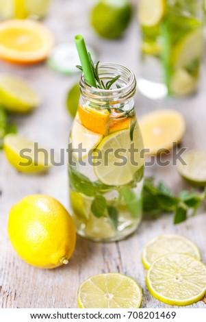 Lemon water in glass bottle. Healthy detox concept #708201469