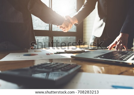 Business partnership meeting concept. Image businessmans handshake. Successful businessmen handshaking after good deal. Group support concept. Royalty-Free Stock Photo #708283213