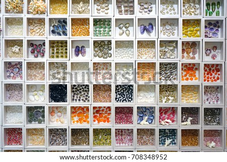 JEJU, SOUTH KOREA -20 JULY 2017- Collection of colorful seashells sorted in white cubby shadowboxes at the World Seashell Museum is located in Seogwipo on Jeju Island. #708348952