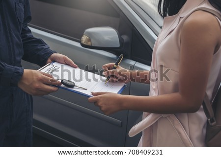 Auto business, car sale, consumerism and people concept -  woman Sign Contract with car dealer in auto show