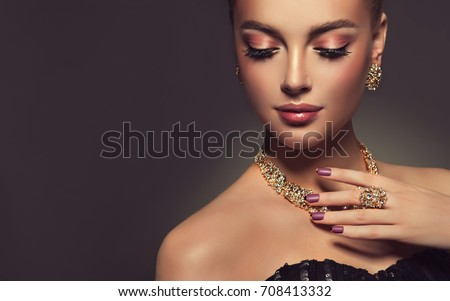 Beautiful girl with jewelry . A set of jewelry for woman ,necklace ,earrings and bracelet. Beauty and accessories. #708413332