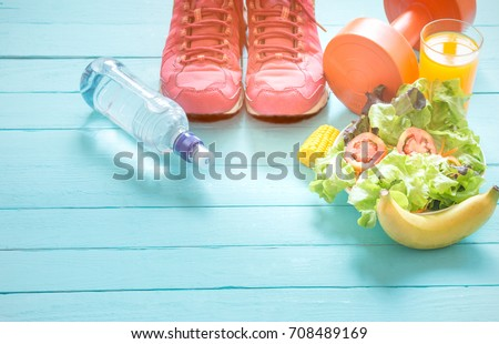 Healthy eating with Workout and fitness dieting ,fitness and weight loss concept, fruit, Vegetable and orange juice,notebook,top view on blue wooden background, Food and health. Royalty-Free Stock Photo #708489169