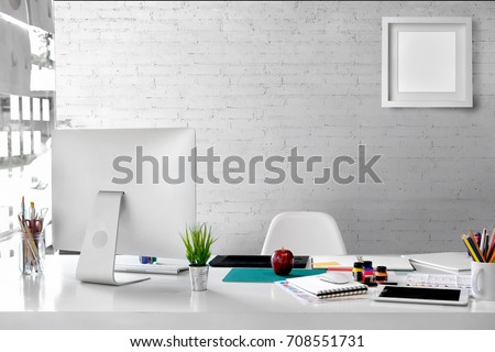 Stylish workspace with desktop computer, office supplies, houseplant and books at home or studio. Blank screen for graphics display montage. #708551731