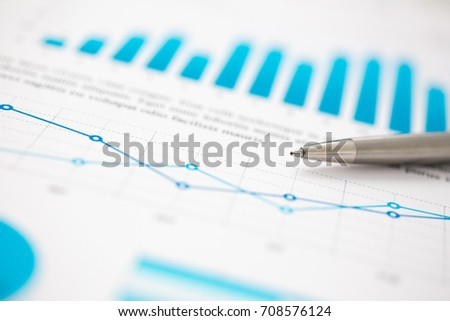 Financial statistics documents ball pen infographics at office table closeup. Internal Revenue Service inspector sum check, investigation, exchange market, earnings, savings, loan and credit concept #708576124