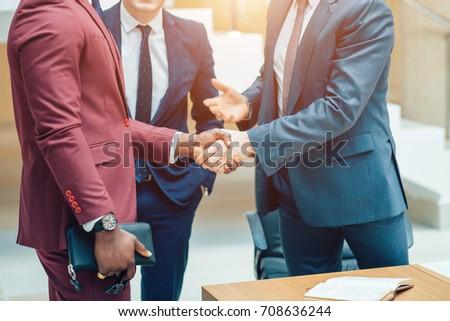 Business partnership meeting concept. Image businessmans handshake. Successful businessmen handshaking after good deal. Horizontal, blurred background Royalty-Free Stock Photo #708636244