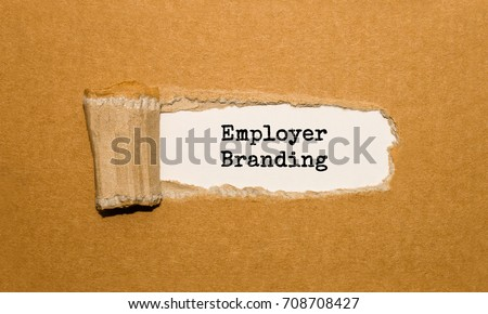 The text Employer Branding appearing behind torn brown paper #708708427