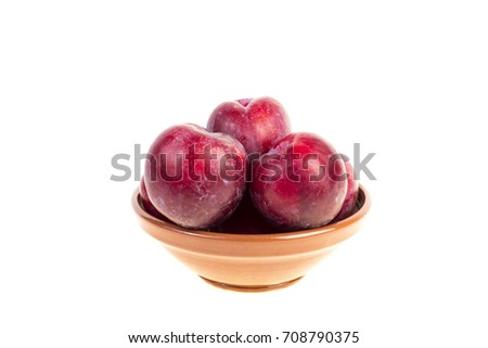 Plum in a bowl on white background #708790375