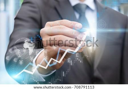 Businessman draws a graph of profit growth .A concept design. #708791113