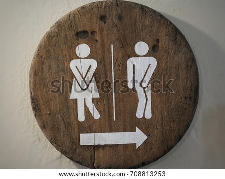 Symbol toilets on the wooden floor,bathroom, men, women.