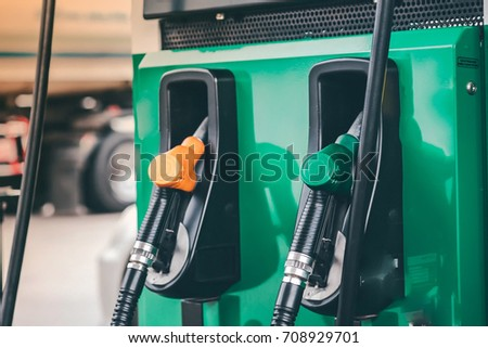 pump filling nozzles  Gas station in a service in warm #708929701
