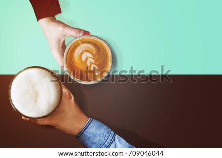 Different Personalities Taste in Beverage of People Concept, Difference Diverse Character of Human Concept, Present by Hand of Male and Female holding Coffee cup and Glass of Beer, Top view #709046044