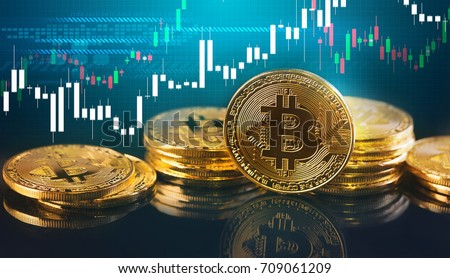 Bitcoins and New Virtual money concept.Gold bitcoins with Candle stick graph chart and digital background.Golden coin with icon letter B.Mining or blockchain technology #709061209