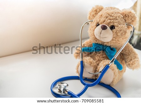Children doctor concept - Teddy Bear with stethoscope. copy space #709085581