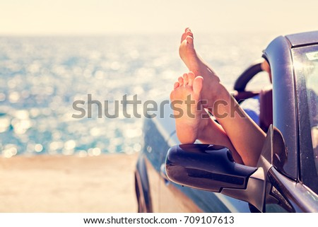 Girl having fun in blue cabriolet against toned sky background. Summer vacation and travel concept #709107613