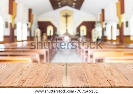 Look out from the table, blur image of inside the church as background.