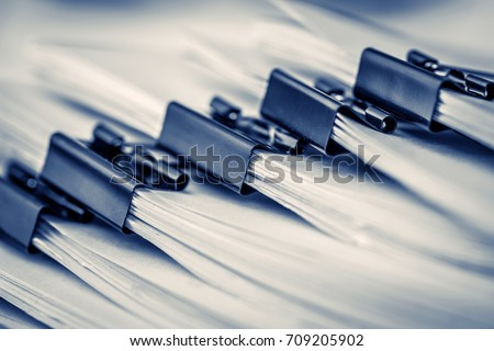 extreamely close up  stacking of office working document with paper clip folder #709205902