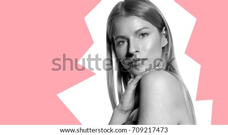 Portrait of a blonde woman with long shiny hair on a white background #709217473