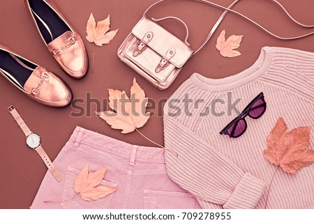 Autumn Arrives. Fashion Lady Clothes Set. Trendy Cozy Jumper. Stylish Gold Handbag Clutch, Glamour Sunglasses. Flat lay. Fall Leaves. Vanilla Pastel autumnal fashionable colors. #709278955