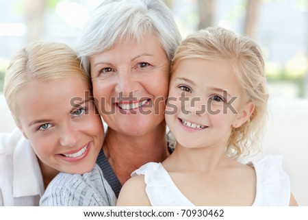 Portrait of a joyful family looking at the camera at home #70930462