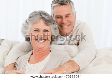 Mature couple looking at the camera at home #70933054