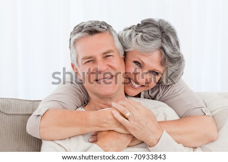 Mature couple looking at the camera at home #70933843