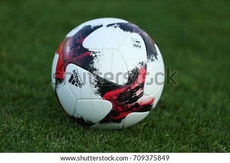KHARKIV, UKRAINE - SEPTEMBER 1, 2017: Adidas European Qualifiers Official Match Ball on the green grass. Open training before FIFA World Cup 2018 Qualifying match Ukraine-Turkey. OSC Metalist Stadium. #709375849