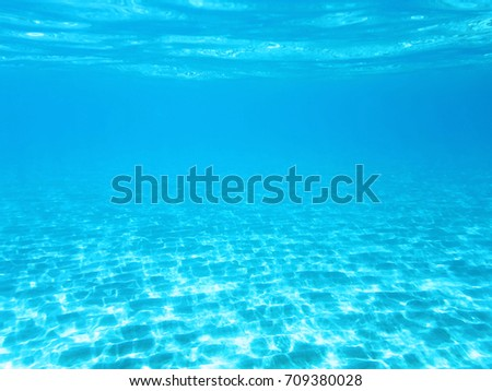 Crystal blue underwater background or wallpaper #709380028