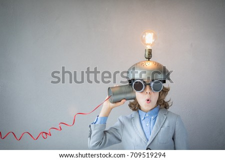 Portrait of child in classroom. Child with toy virtual reality headset in class. Funny kid with light bulb. Communication, idea and innovation technology concept. Back to school Royalty-Free Stock Photo #709519294