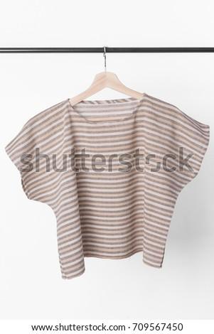 cotton brown stripe woman blouse on white background. #709567450