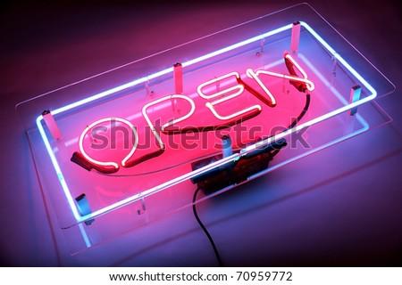 an open neon sign
