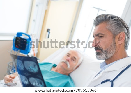 doctor showing patient his xray results #709615066