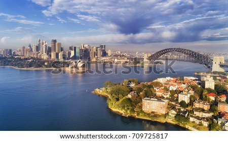 Quiet still earlier morning gentle sun light over Sydney city main landmarks around Harbour waters and shores between CBD and lowe North Shore. #709725817