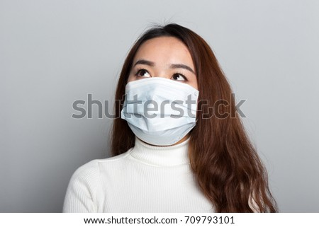 A Chinese young woman with a medical mask #709793101