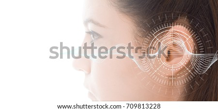 Hearing test showing ear of young woman with sound waves simulation technology Royalty-Free Stock Photo #709813228