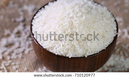 Close up of white rice in the wooden bowl. #710120977