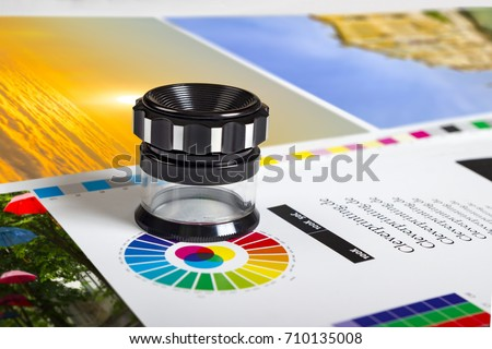 Print loupe on offset printed sheet with basic colors controll bars Royalty-Free Stock Photo #710135008