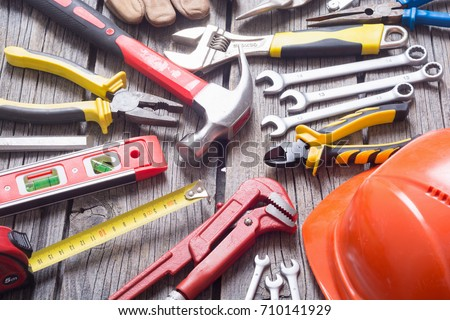 Set of tools on wooden background . #710141929